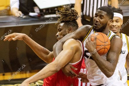 Stock Image of Missouri's Jeremiah Tilmon, right, wrestles a rebound away from Bradley's Ari Boya, left, during the second half of an NCAA college basketball game, in Columbia, Mo