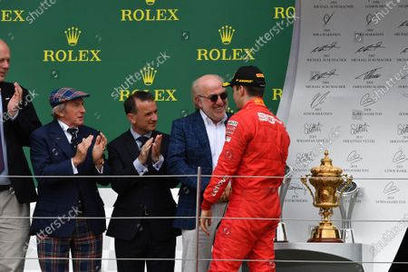 Charles Leclerc, Ferrari, 3rd position, is greeted by David Richards on the podium