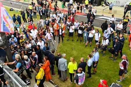 The Sky Sports F1 team (Natalie Pinkham, Paul di Resta, Johnny Herbert, Rachel Brookes, Simon Lazenby, Martin Brundle, David Croft, Damon Hill, Jenson Button, Anthony Davidson and Karun Chandhok) watch Lewis Hamilton, Mercedes AMG F1, celebrating