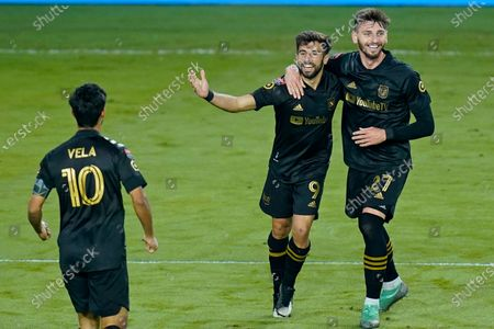 Stock Photo of Los Angeles FC forward Diego Rossi (9) celebrates his goal against Tigres with defender Tristan Blackmon (27) and forward Carlos Vela (10) during the second half of a CONCACAF Champions League soccer match, in Orlando, Fla