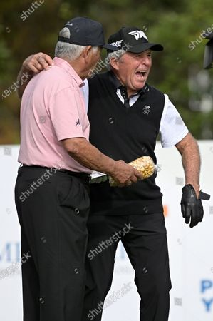 Lee Trevino, left, and Gary Player, of South Africa, share a laugh on the first hole before hitting their tee shots during the first round of the PNC Championship golf tournament, in Orlando, Fla
