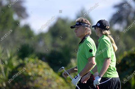 Bernhard Langer, left, of Germany, and his daughter Jackie Langer John walk to their ball on the third green during the first round of the PNC Championship golf tournament, in Orlando, Fla