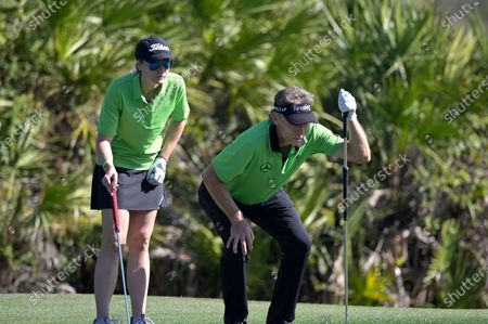 Bernhard Langer, right, of Germany, and his daughter Jackie Langer John line up their putt on the third green during the first round of the PNC Championship golf tournament, in Orlando, Fla