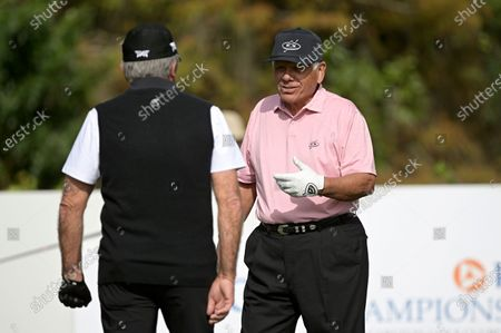 Lee Trevino, right, and Gary Player, of South Africa, talk on the first hole before hitting their tee shots during the first round of the PNC Championship golf tournament, in Orlando, Fla