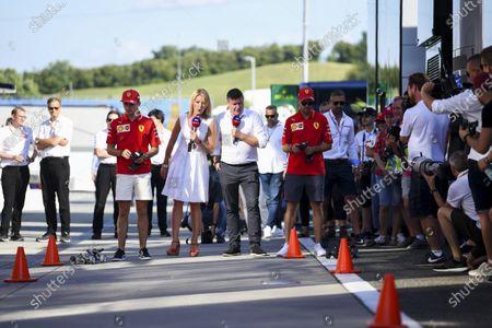 Charles Leclerc, Ferrari, David Croft, Sky TV, Rachel Brookes, Sky TV and Sebastian Vettel, Ferrari during the Sky TV remote control car challenge in the paddock
