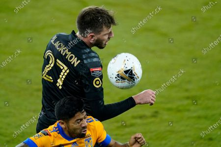 Los Angeles FC defender Tristan Blackmon (27) gets position on the ball in front of Tigres midfielder Javier Aquino, below, during the first half of a CONCACAF Champions League soccer match, in Orlando, Fla