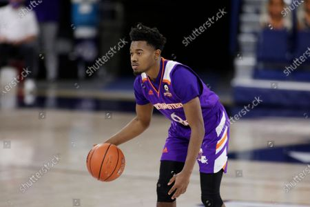 Northwestern State guard CJ Jones brings the ball up the court during the first half of an NCAA college basketball game against Gonzaga in Spokane, Wash