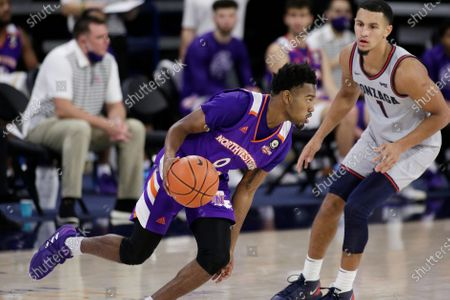 Stock Photo of Northwestern State guard CJ Jones (0) dribbles the ball while pressured by ]Gonzaga guard Jalen Suggs (1) during the second half of an NCAA college basketball game in Spokane, Wash
