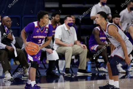 Stock Image of Northwestern State guard Brian White, left, holds the ball while pressured by Gonzaga guard Jalen Suggs during the second half of an NCAA college basketball game in Spokane, Wash