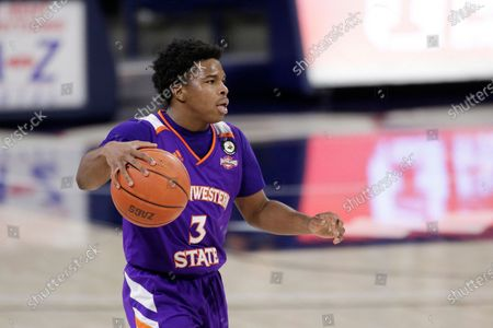 Northwestern State guard Brian White brings the ball up the court during the second half of an NCAA college basketball game against Gonzaga in Spokane, Wash
