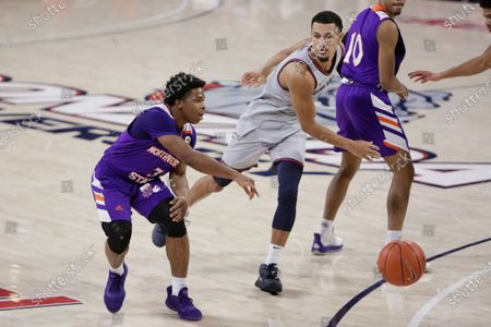 Northwestern State guard Brian White, left, passes the ball past Gonzaga guard Jalen Suggs during the second half of an NCAA college basketball game in Spokane, Wash
