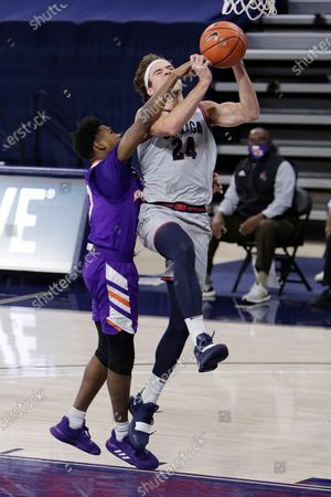 Gonzaga forward Corey Kispert, right, shoots while pressured by Northwestern State guard CJ Jones during the first half of an NCAA college basketball game in Spokane, Wash