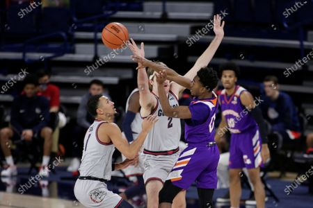 Northwestern State guard CJ Jones (0) passes the ball past Gonzaga guard Jalen Suggs (1) and forward Drew Timme (2) during the first half of an NCAA college basketball game in Spokane, Wash