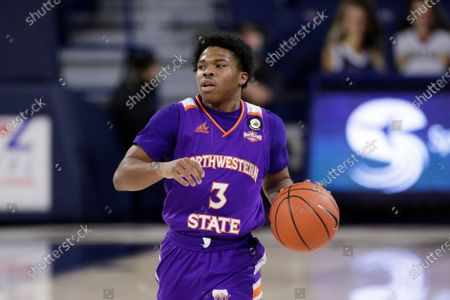 Stock Photo of Northwestern State guard Brian White brings the ball up the court during the first half of an NCAA college basketball game against Gonzaga in Spokane, Wash
