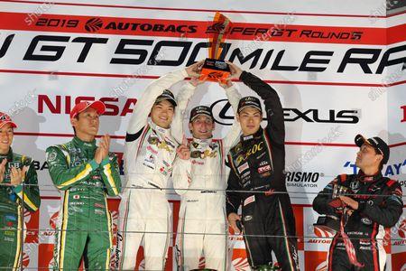 Stock Photo of GT300 Winners Tsubasa Takahashi, Andre Couto & Kiyoto Fujinami,  T-DASH JLOC LAMBORGHINI HURRACAN GT3, celebrate on the podium ahead of Shigekazu Wakisaka & Hiroki Yoshida SAITAMA TOYOPET GB Toyota MARK X MC, 2nd, and Ryo Michigami & Hiroki Otsu, Modulo Drago Corse KENWOOD Honda NSX GT3, 3rd