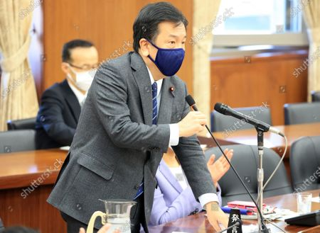 Japan's main opposition Constitutional Democratic Party of Japan leader Yukio Edano questions to Land, Infrastructure, Transport and Tourism Minister Kazuyoshi Akaba at Lower House's land, infrastructure, transport and tourism committee session at the National Diet in Tokyo on Wednesday, December 23, 2020.