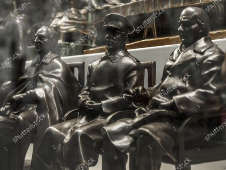 Stock Image of A group of three leaders of the anti-Hitler coalition inaccurately repeats the famous photograph from the Yalta conference in 1945. In fact, Churchill sat on the left, Roosevelt in the center, Stalin on the right. Statuettes of Franklin D. Roosevelt, Joseph Stalin  and Winston Churchilll on the showcase of a souvenir shop.