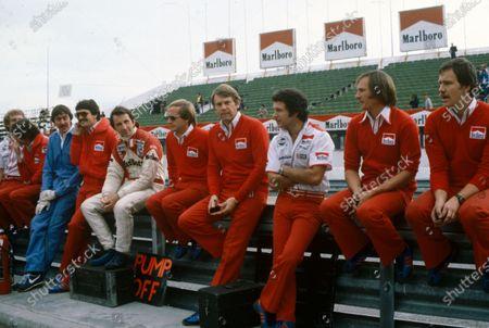 Tyler Alexander, John Watson, and Tony Jardine, among McLaren team members on the pit wall.