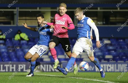 Kamil Jozwiak of Derby County  competes with Adam Clayton  and Jake Clarke-Salter of Birmingham City