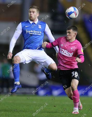 Adam Clayton of Birmingham City battles with Jason Knight of Derby County