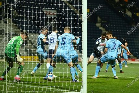 Sean Maguire of Preston North End scores his sides second goal