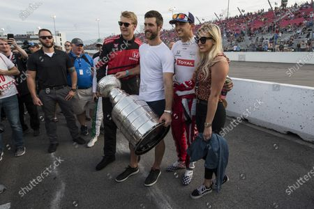 Graham Rahal, Rahal Letterman Lanigan Racing Honda and his wife Courtney Force pose with St. Louis Blues players Colton Parayko and Alex Pietrangelo and The Stanley Cup.