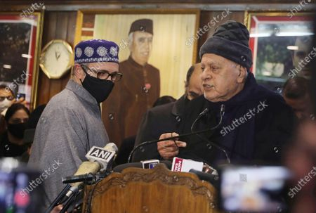 Member of the Indian Parliament and President of the Jammu and Kashmir National Conference (NC) Farooq Abdullah (R), along with former chief minister for Jammu and Kashmir Omar Abdullah (L), addresses party workers a day after the District Development Council elections results in Srinagar, the summer capital of Indian Kashmir, 23 December 2020. Farooq Abdullah and former chief minister Jammu and Kashmir Omar Abdullah's address comes after Peoples Alliance for Gupkar Declaration (PAGD), an amalgam of different political parties of Jammu and Kashmir formed to restore the special status of the erstwhile state, won 112 out of a total 280 seats in the District Development Council (DDC) election.
