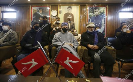 Member of the Indian Parliament and President of the Jammu and Kashmir National Conference (JKNC) Farooq Abdullah (2-L) and former chief minister for Jammu and Kashmir Omar Abdullah (3-L) attend a meeting with his party workers a day after the District Development Council elections results in Srinagar, the summer capital of Indian Kashmir, 23 December 2020. Farooq Abdullah and former chief minister Jammu and Kashmir Omar Abdullah's address comes after Peoples Alliance for Gupkar Declaration (PAGD), an amalgam of different political parties of Jammu and Kashmir formed to restore the special status of the erstwhile state, won 112 out of a total 280 seats in the District Development Council (DDC) election.
