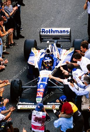 Jacques Villeneuve, Williams FW19 Renault, celebrates at the end of the race.