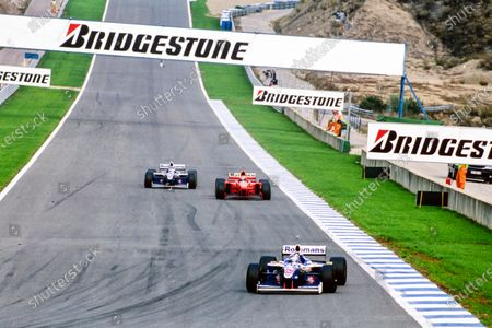 Heinz-Harald Frentzen, Williams FW19 Renault, leads Michael Schumacher, Ferrari F310B, and Jacques Villeneuve, Williams FW19 Renault.