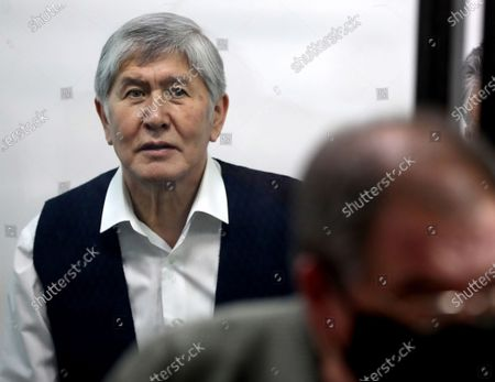 Stock Photo of Former Kyrgyzstan president Almazbek Atambayev attends a court hearing on the events in the village of Koy-Tash in Bishkek, Kyrgyzstan, 23 December 2020. Special forces of the State Committee for National Security tried to detain the Atambayev on 07 August 2019 in the village of Koy-Tash in order to bring him for interrogation to the Prosecutor General's Office. Almazbek Atambayev is charged with an article on organizing mass riots, the State Committee for National Security of Kyrgyzstan said.