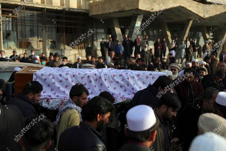 Afghans carry the coffin of Mohammad Yousuf Rasheed, executive director of the non-governmental Free and Fair Election Forum of Afghanistan, during his funeral ceremony, in Kabul, Afghanistan, . Nikzad, a prominent local journalist was shot dead by unknown assailants in Afghanistan's central Ghazni province on Monday