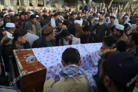Stock Photo of Afghans carry the coffin of Mohammad Yousuf Rasheed, executive director of the non-governmental Free and Fair Election Forum of Afghanistan, during his funeral ceremony, in Kabul, Afghanistan, . Rasheed, a prominent local journalist was shot dead by unknown assailants in Afghanistan's central Ghazni province on Monday