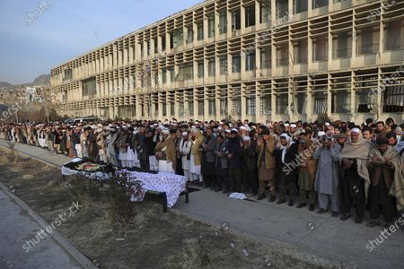 Stock Image of People offer prayers over the coffin of Mohammad Yousuf Rasheed, executive director of the non-governmental Free and Fair Election Forum of Afghanistan, during his funeral ceremony, in Kabul, Afghanistan, . Separate bombing and shooting attacks in Afghanistan's capital left several people dead Wednesday, including Rasheed, the head of the independent elections watchdog, officials said
