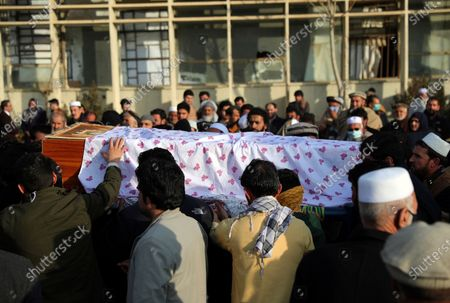 Afghan people carry the coffin of Mohammad Yousuf Rasheed, executive director of the non-governmental Free and Fair Election Forum of Afghanistan, during his funeral ceremony, in Kabul, Afghanistan, . Separate bombing and shooting attacks in Afghanistan's capital left several people dead Wednesday, including Rasheed, the head of the independent elections watchdog, officials said