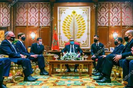 In this photo released by the Royal Palace, Morocco's King Mohammed VI, center flanked by the Crown Prince Moulay El Hassan 3 rd right sitw with Senior White House adviser Jared Kushner, 2nd left and Meir Ben Shabbat, National Security Advisor of the 'State of Israel as Morocco's Primer Saad Eddine El Othmani 2nd right and Senior king adviser Fouad Ali Al Hima, right look on at the king's palace in Rabat, Morocco, . Kushner departed Tuesday on the first known direct flight since the two countries established diplomatic ties this month as part of a series of U.S.-brokered normalization accords with Arab countries. At left is Meir Ben-Shabbat, National Security Advisor of the State of Israel