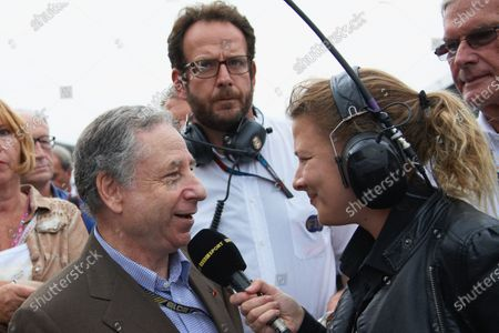 Jean Todt is interviewed by BBC Sport's Jennie Gow on the grid.