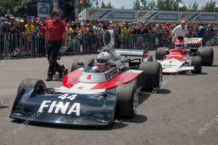 Dieter Quester, Surtees TS16 ahead of Helmut Marko, BRM P153 waiting for the Legends Parade.