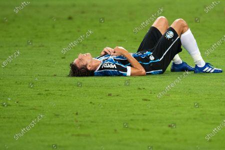 Pedro Geromel of Gremio llies injured on the pitch; Arena de Gremio, Porto Alegre, Rio Grande do Sul, Brazil; Brazilian Cup Football, Gremio versus Sao Paulo.