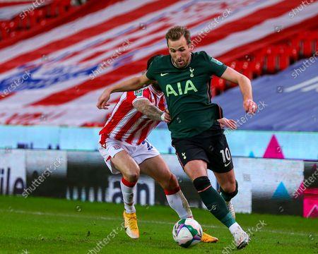 Harry Kane of Tottenham Hotspur is shackled by Steven Fletcher of Stoke City