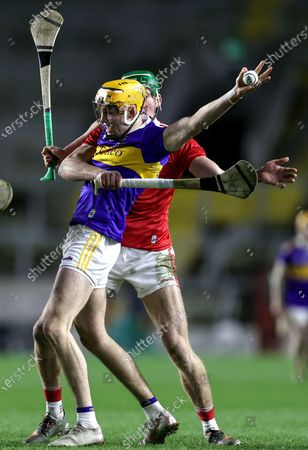 Stock Image of Cork vs Tipperary. Tipperary's Conor Whelan and Colin O'Brien of Cork