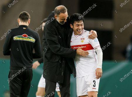 Stuttgart's head coach Pellegrino Matarazzo (L)  and Stuttgart's Wataru Endo react after the German DFB Cup second round soccer match between VfB Stuttgart and SC Freiburg in Stuttgart, Germany, 23 December 2020.