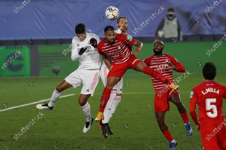 Stock Image of Real Madrid's Raphael Varane (L) and Sergio Ramos (back) in action against Granada CF's Yangel Herrera (C) during a Spanish LaLiga soccer match between Real Madrid and Granada CF at Alfredo Di Stefano stadium in Madrid, Spain, 23 December 2020.