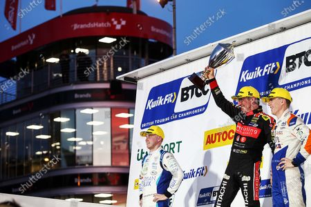 Stock Picture of BTCC Race 3 Podium, Ash Sutton (GBR) Team BMR Subaru Levorg, Jason Plato (GBR) Power Maxed Racing Vauxhall and Rory Butcher (GBR) AmD Tuning Honda Civic