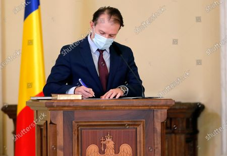 Romanian new Prime Minister Florin Catu signs the documents during the swearing in ceremony held at the Presidential Palace, in Bucharest, Romania, 23 December 2020. Catu, former Finance Minister, was nominated as prime minister by the Romanian president Klaus Iohannis. Catu's cabinet passed parliament with a final tally of 260 for and 186 votes against.