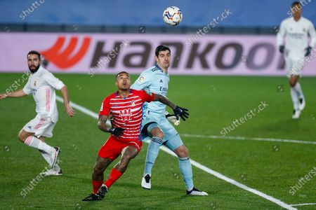 Robert Kenedy of Granada and Thibaut Courtois of Real Madrid in action during the spanish league, La Liga Santander, football match played between Real Madrid and Granada CF at Ciudad Deportiva Real Madrid on december 23, 2020, in Valdebebas, Madrid, Spain
