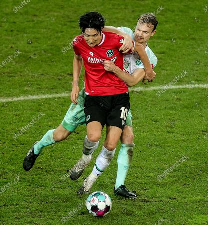Stock Image of Genki Haraguchi of Hannover (L) in action against  Bremen's Christian Gross during the German DFB Cup second round soccer match between Hannover 96 and Werder Bremen in Hanover, Germany, 23 December 2020.