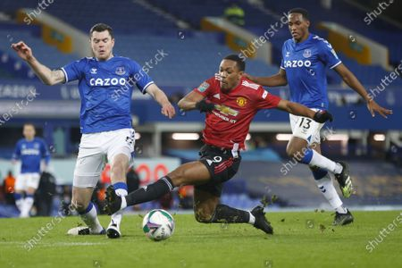 Stock Photo of Anthony Martial (C) of Manchester United in action against Michael Keane (L) and Yerry Mina (R) of Everton during the Carabao Cup quarter final mach between Everton and Manchester United in Liverpool, Britain, 23 December 2020.