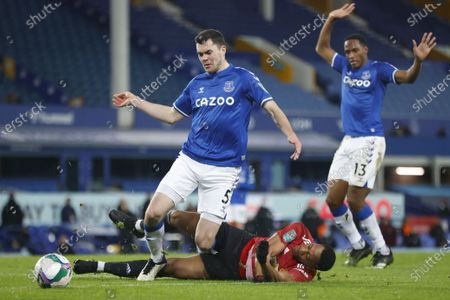 Stock Picture of Anthony Martial (C) of Manchester United in action against Michael Keane (L) and Yerry Mina (R) of Everton during the Carabao Cup quarter final mach between Everton and Manchester United in Liverpool, Britain, 23 December 2020.