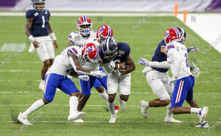 Stock Photo of Georgia Southern receiver Darius Lewis (10) is tackled by a host of Louisiana Tech defenders including Jaiden Cole (7), Zach Hannibal (2), BeeJay Williamson (4) and Ezekiel Barnett (46) during the R+L Carriers New Orleans Bowl between the Louisiana Tech Bulldogs and the Georgia Southern Eagles at the Mercedes Benz Superdome in New Orleans, LA